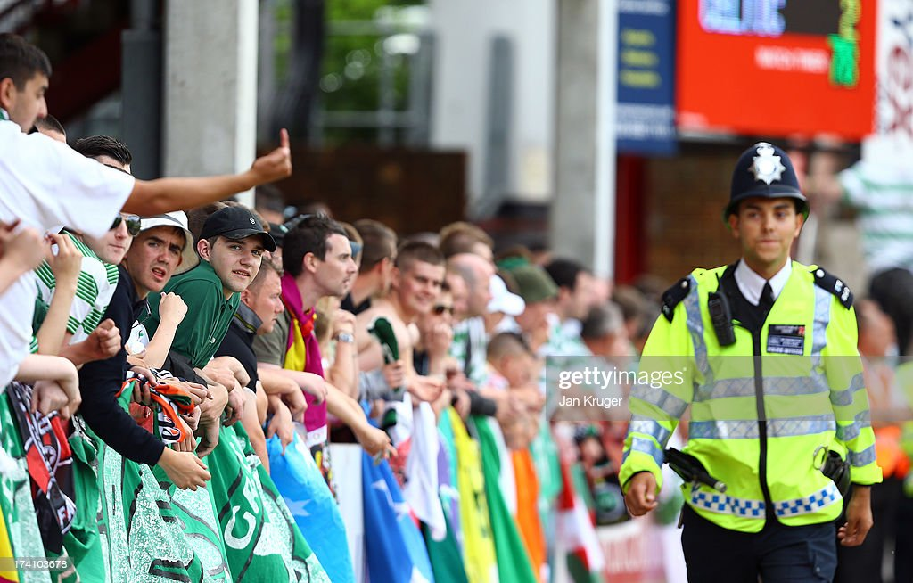 Traveling fans look on during a pre season friendly match between Brentford and Celtic at Griffin Park on July 20, 2013 in Brentford, England.