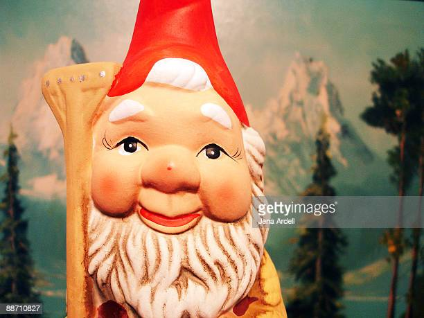 traveling garden gnome visits swiss alps - gnome stock pictures, royalty-free photos & images