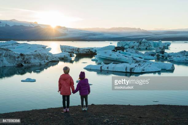 traveling iceland with kids - global warming stock pictures, royalty-free photos & images