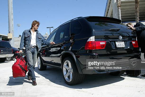 Traveling in style outfielder Tsuyoshi Shinjo leaves the New York Mets' spring training camp in Port St Lucie Fla in a custom BMW X5 after...