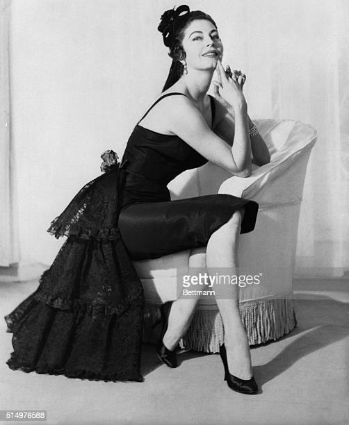 Traveling lady Ava Gardner who's always on the go stops in Rome long enough to model this creation part of the wardrobe made for her by the Fontana...
