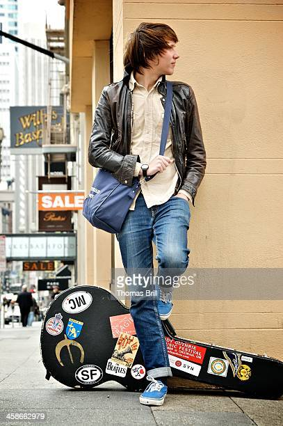 traveling musician - guitar case stock pictures, royalty-free photos & images