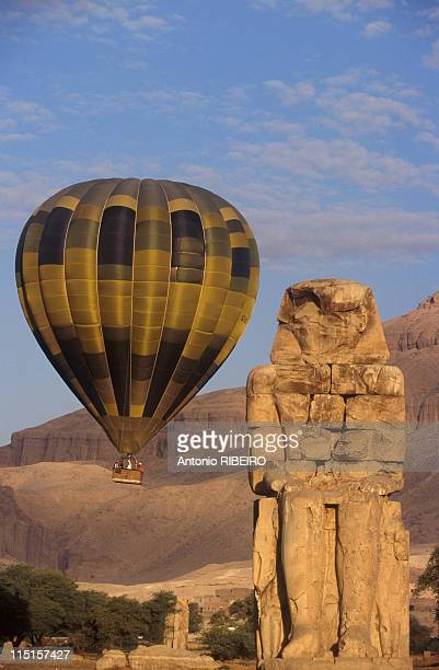 Traveling on the Nile in Egypte in October 1997 Balloon flying behind of the colossi of Memnon