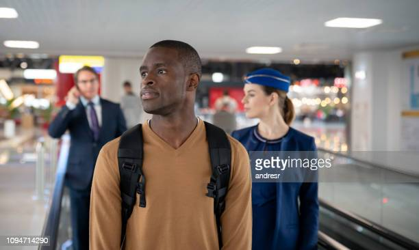 Traveling people on a moving walkway at the airport