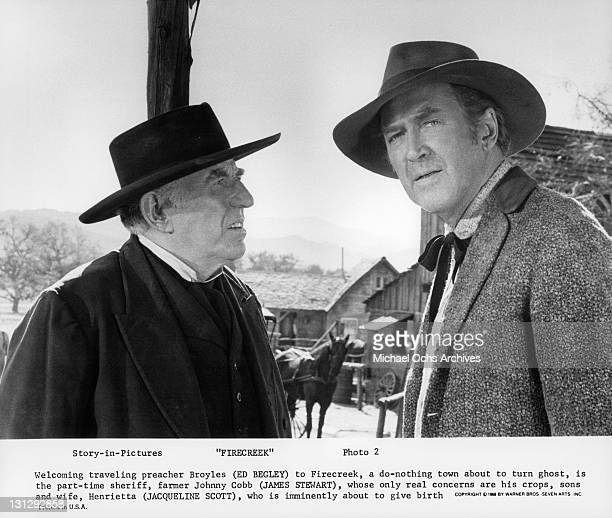 Traveling preacher Ed Begley is welcomed by James Stewart in a scene from the film 'Firecreek' 1968