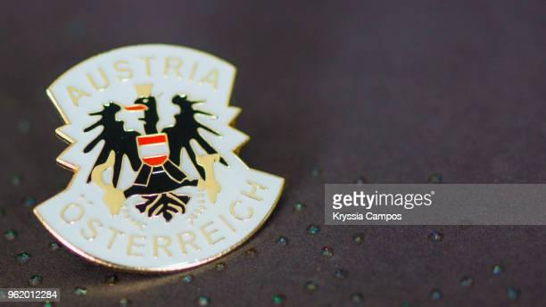 traveling souvenir: pin brooch from austria - brooch stock-fotos und bilder