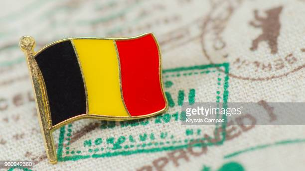 traveling souvenir: pin brooch from belgium - broche stock pictures, royalty-free photos & images