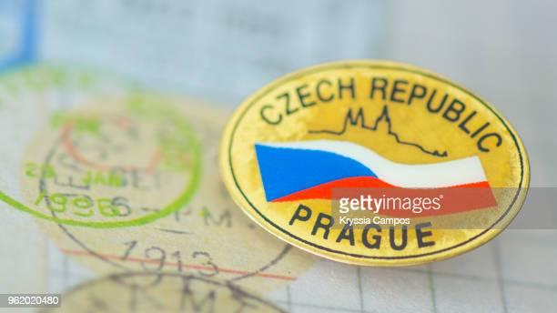 traveling souvenir: pin brooch from czech republic - brooch stock-fotos und bilder