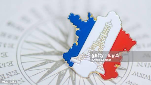 traveling souvenir: pin brooch from france - carte france photos et images de collection