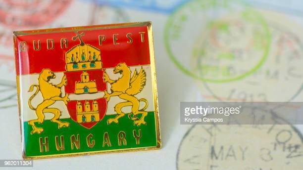 traveling souvenir: pin brooch from hungary - brooch stock-fotos und bilder