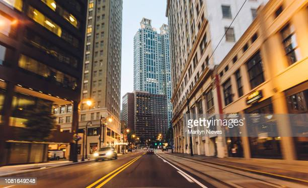 traveling through the city at dusk - financial district stock pictures, royalty-free photos & images