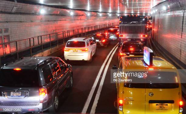 Traveling through the Lincoln Tunnel, beneath the Hudson River, between Wehawken, New Jersey, and Manhattan, NYC.
