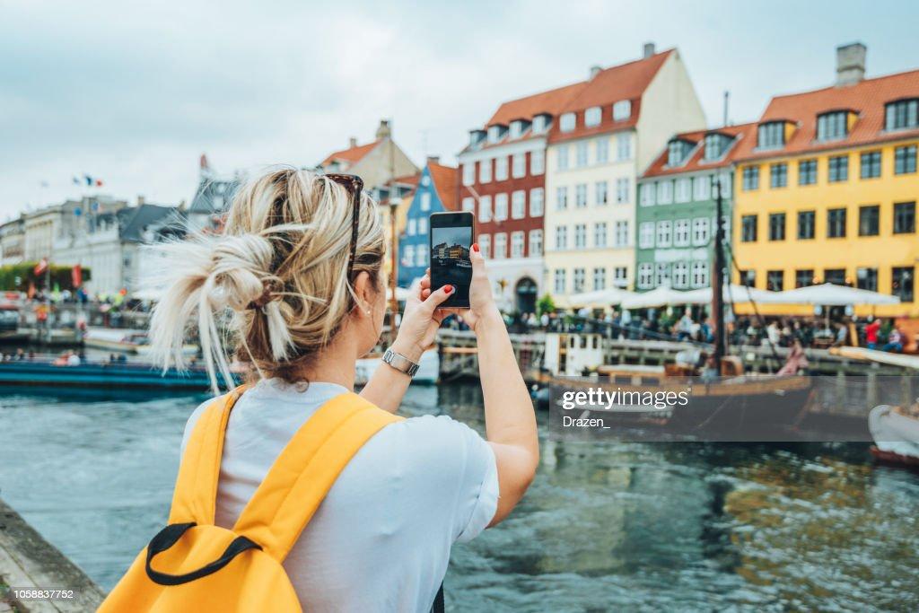 Traveling to Copenhagen - tourist in Nyhavn : Stock Photo