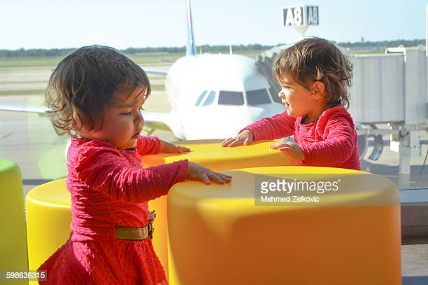 Traveling with toddler girl twins at airport