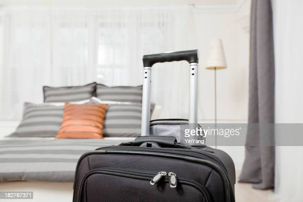 Traveling—Black Business Roller Suitcase by Hotel Room Bed Hz