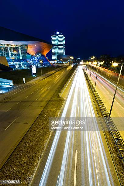 Travelled road outside the BMW Museum, in the front, and the BMW head quarters, in the back, in München. The long shutter speed allow for the car...