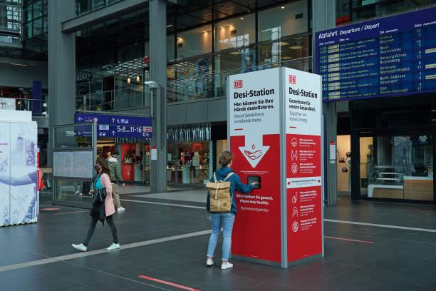 DEU: Deutsche Bahn Offers Face Masks To Travellers