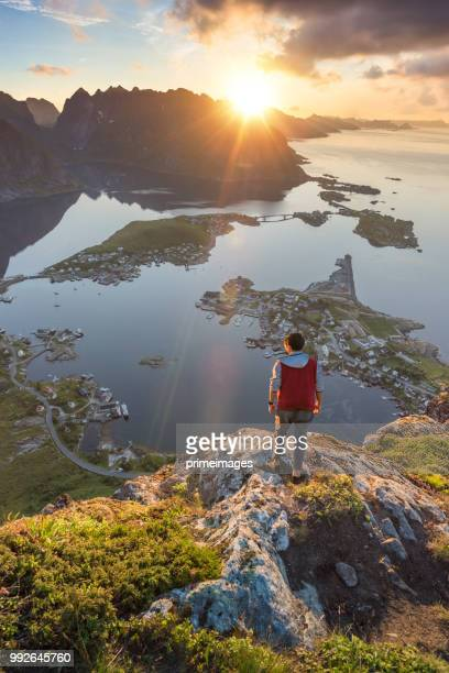 traveller enjoy summer view of lofoten islands in norway with sunset scenic - lofoten stock pictures, royalty-free photos & images