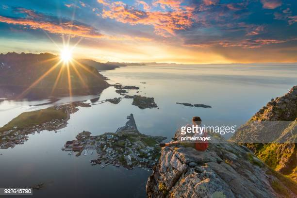 traveller enjoy summer view of lofoten islands in norway with sunset scenic - north stock pictures, royalty-free photos & images