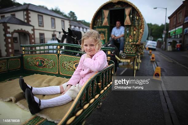 Traveller girl Mary Nicholson aged six arrives on her family's Romany Caravan at the Appleby Horse Fair on June 7 2012 in Appleby England Appleby...