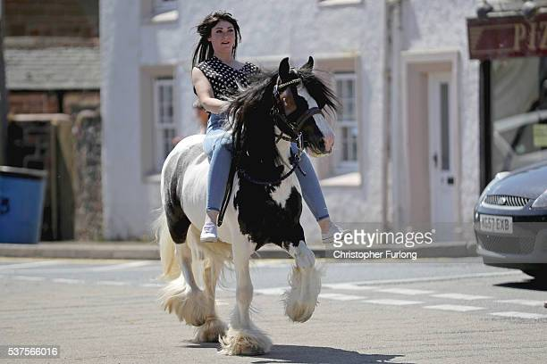 A traveller girl rides her horse through Appleby during the Appleby Horse Fair on June 2 2016 in Appleby England The Appleby Horse Fair has existed...