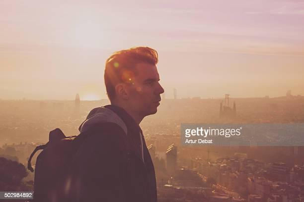 Traveller guy from the Barcelona bunkers (Turo de la Rovira) with the Barcelona cityscape on beautiful sunrise light.