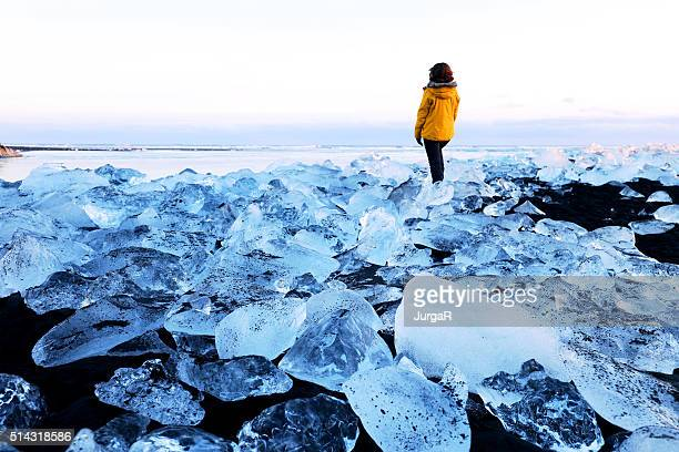 Traveller in Surreal Ice Landscape on Jokulsarlon Coast in Iceland