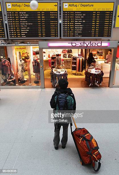 A traveller looks at a departures board at Tegel Airport on December 30 2009 in Berlin Germany Germany has increased security measures in the past...