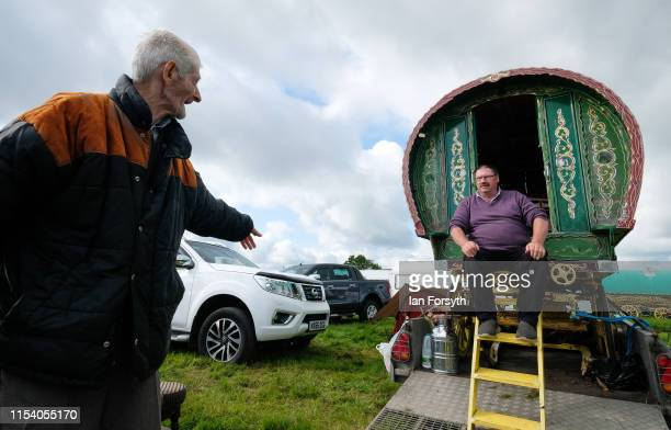 Traveller Mala Blenkinsop sits in his bow top caravan talking to a fellow traveller on the first day of the Appleby Horse Fair on June 06 2019 in...