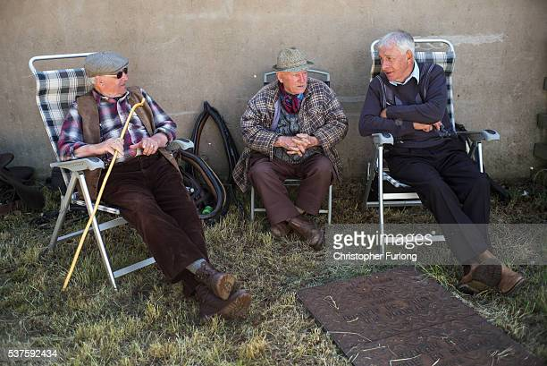 Traveller men chat and enjoy the sunshine during the Appleby Horse Fair on June 2 2016 in Appleby England The Appleby Horse Fair has existed under...