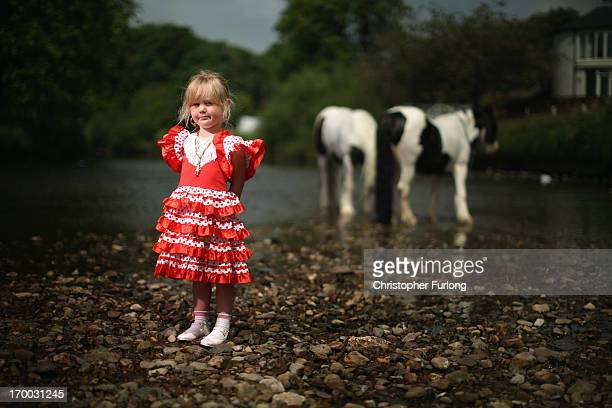 Traveller Milly Edwards, aged 3, poses next to the River Eden during the Appleby Horse Fair on June 6, 2013 in Appleby, England. The Appleby Horse...
