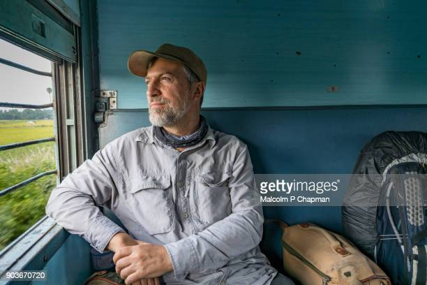 traveller on indian train - railway passenger - passenger stock pictures, royalty-free photos & images