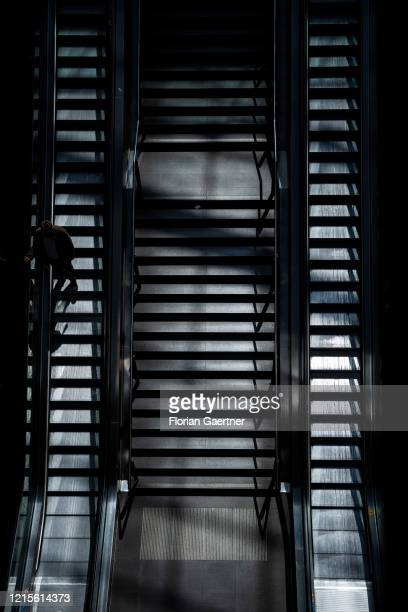 Traveller on stairs are pictured at the main train station on May 27, 2020 in Berlin, Germany.