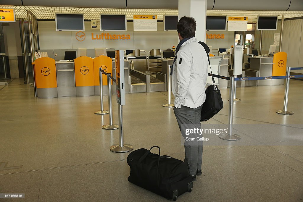 A traveller stands in front of a closed Lufthansa check-in counter at Tegel Airport during a nationwide strike by Lufthansa ground, service and maintenance personnel on April 22, 2013 in Berlin, Germany. Workers are demanding pay raises and job guarantees and today's strike has forced Lufthansa to cancel approximately 1700 flights.
