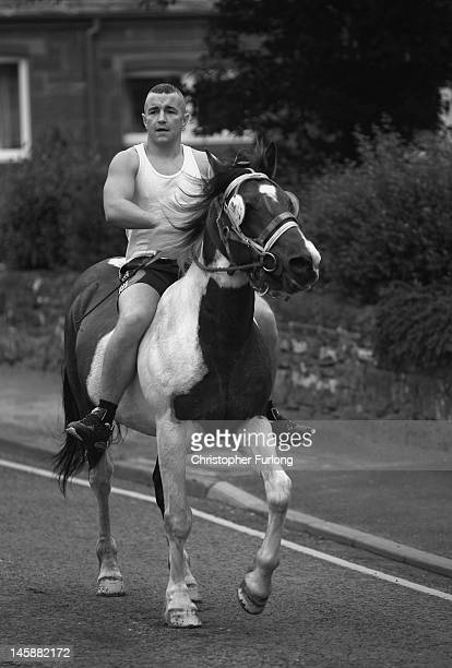 A traveller takes his horse to the River Eden for washing during the Appleby Horse Fair on June 7 2012 in Appleby England Appleby Horse Fair has...