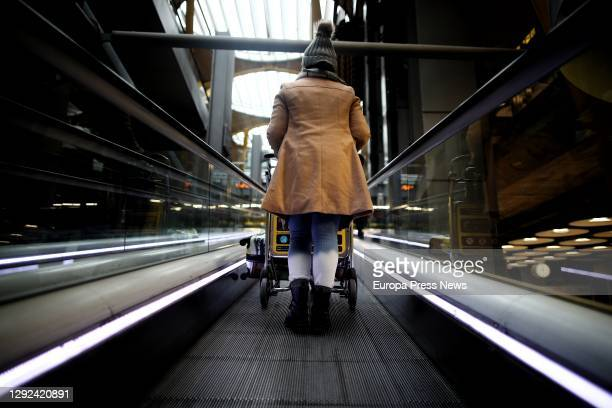 Traveller using the escalator in T4 terminal at Adolfo Suárez Madrid-Barajas Airport, one day before the suspension of flights from the United...