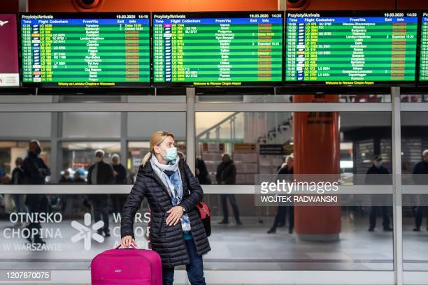 Traveller walks at the arrivals hall at Warsaw Chopin airport as nationals arriv from abroad with additional flights organised by Polish government...