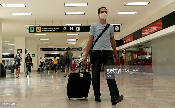 A traveller wearing a face mask at Benito Juarez airport in Mexico City April 29 2009 The European Commission said Wednesday it would wait with a ban...