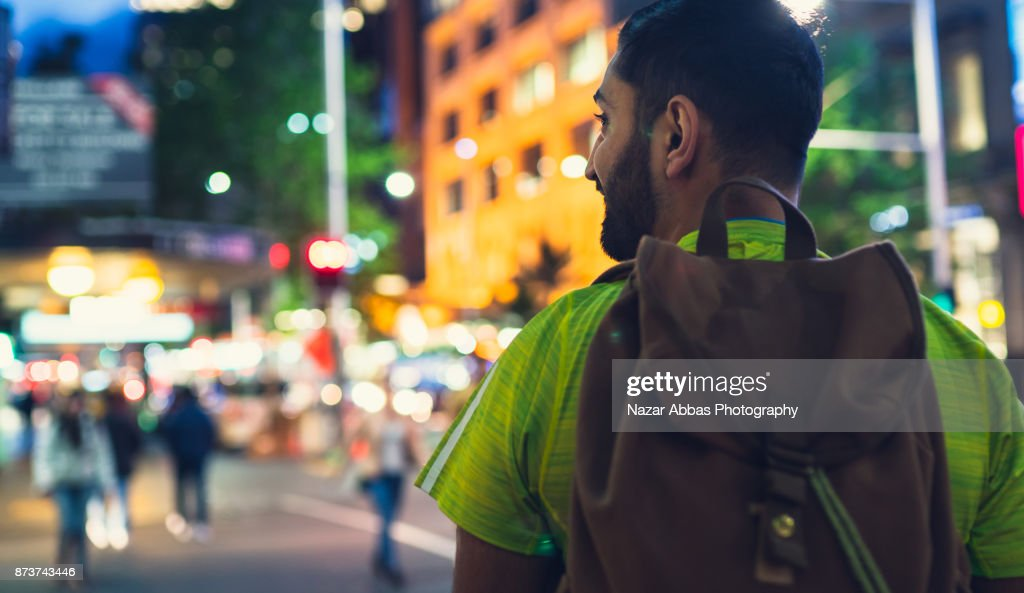 Traveller with backpack in city and enjoying the travel. : Stock Photo