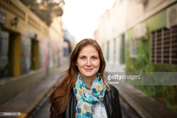 traveller woman walking through the city - palermo buenos aires stock photos and pictures