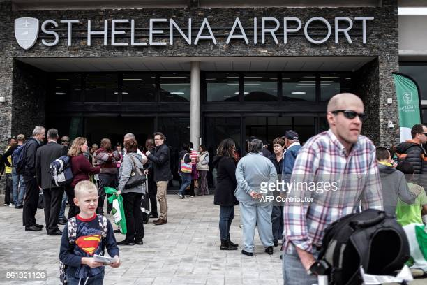 Travellers and passengers leave after disembarking from the first inaugural commercial plane from Johannesburg at the newly built Saint Helena...