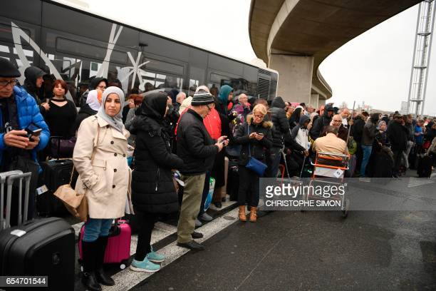 TOPSHOT Travellers are evacuated from Paris' Orly airport on March 18 2017 following the shooting of a man by French security forces Security forces...