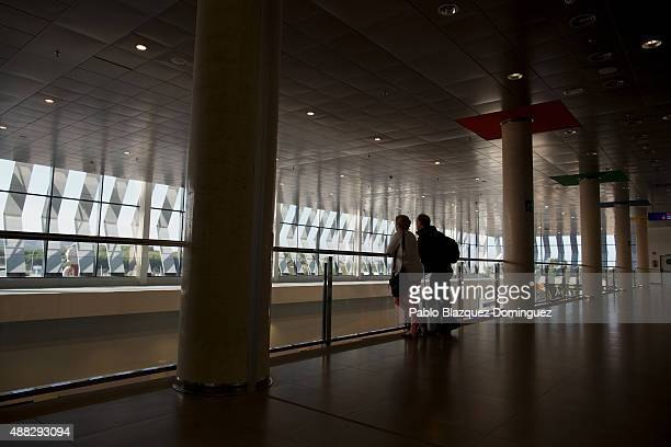Travellers are seen before the first commercial flight takes off at Castellon airport on September 15 2015 near Castellon de la Plana in Castellon...