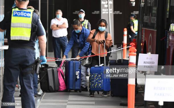 Travellers arrive at a hotel in Melbourne on December 7, 2020 where Australians returning from overseas will quarantine as part of precautions...