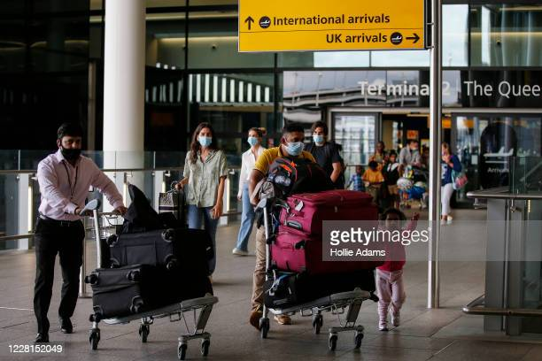 Travellers arrive at Heathrow Airport on August 22, 2020 in London, England. As of Saturday morning at 4am, travellers arriving in England from...