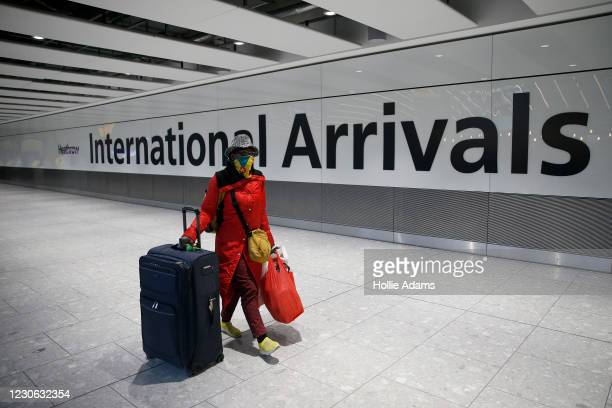 """Travellers arrive at Heathrow Airport on January 17, 2021 in London, England. Tomorrow morning the UK will close its so-called """"travel corridors""""..."""