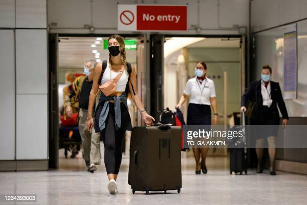 Travellers arrive at Heathrow's Terminal 5 in west London on August 2, 2021 as quarantine restrictions ease. - People fully vaccinated in the United...