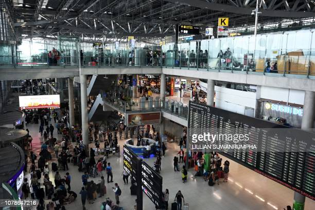 Travellers arrive at the Suvarnabhumi international airport in Bangkok on January 7 2019 An injunction has been filed at Bangkok's Criminal Court to...