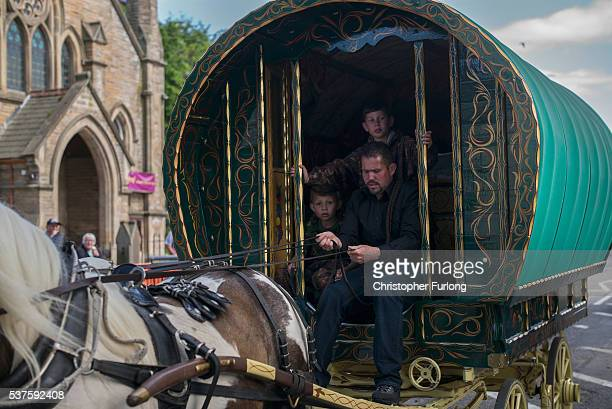Travellers arrive on their bow top caravans for the Appleby Horse Fair on June 2 2016 in Appleby England The Appleby Horse Fair has existed under the...