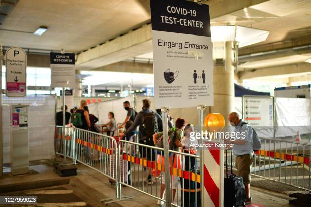 Travellers arriving from abroad wait to be tested at a Covid-19 testing station set up at Hanover-Langenhagen Airport on August 8, 2020 near Hanover,...